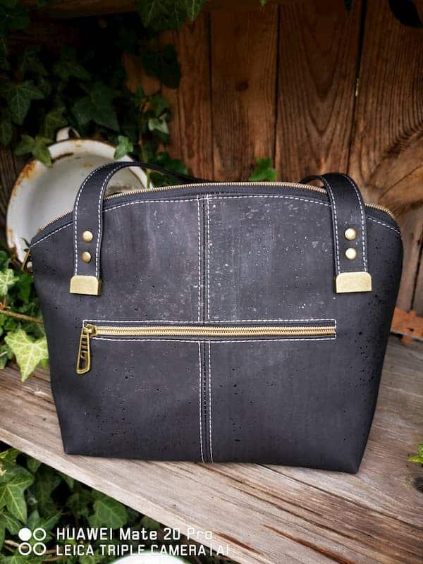 zwarte schoudertas achterkant