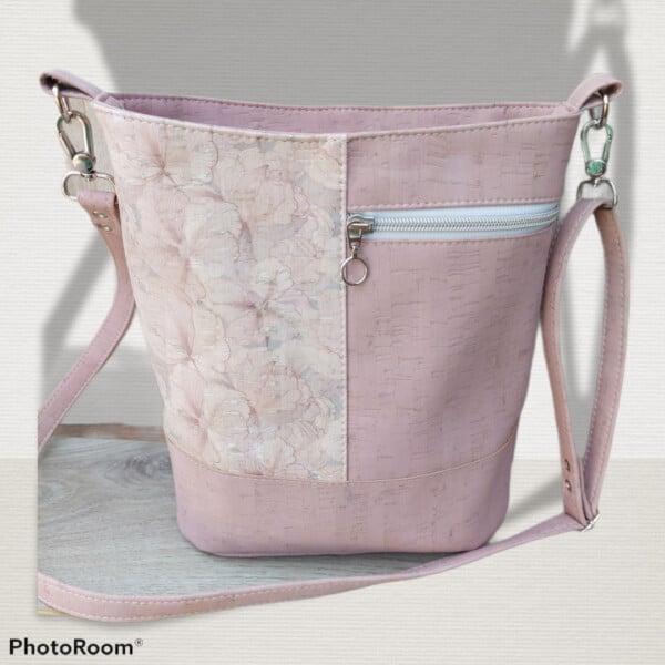 kurk tas-schoudertas roze met witte details