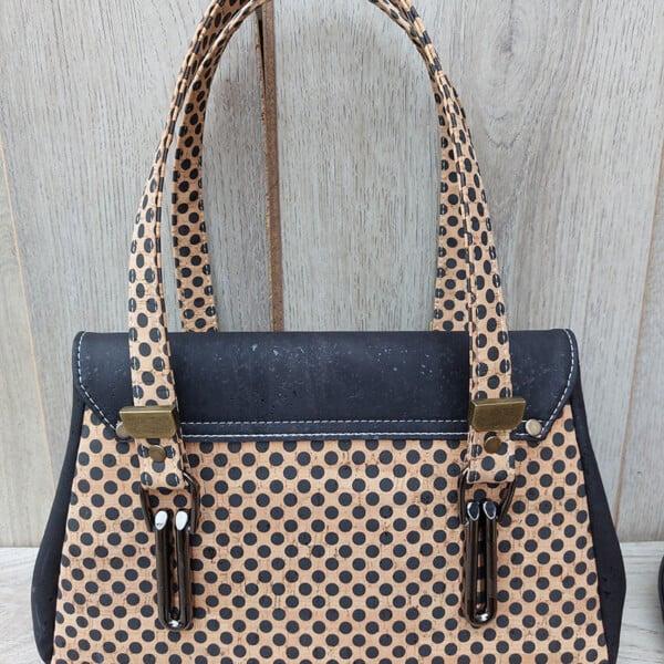 kurk handtas zwart met stippen achterkant